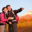 Couple using travel app or map on hike — Stock Photo #52887037