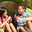 Couple drinking water in tent — Stock Photo #52887055