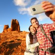 Couple taking self portrait hiking — Stock Photo #52887075