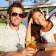 Couple drinking alcohol at beach club — Stock Photo #52887305