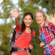 Hiking women waving hello — Stock Photo #52887431
