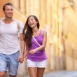 Couple holding hands walking — Stock Photo #52887691