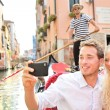 Travel couple in Venice on Gondole ride — Stock Photo #52887735
