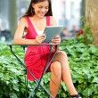 Woman using tablet pc in Bryant Park — Stock Photo #52887803
