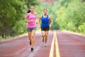 Couple training on road — Stock Photo