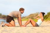 Couple working out in sand — Stock Photo