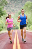 Runners jogging on road — Stock Photo