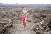 Woman running on volcano — Stockfoto