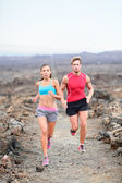 Couple running on trail in country — Stock Photo
