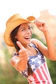 Cowgirl giving thumb up in countryside — Stock Photo