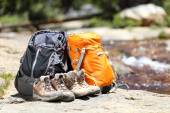 Hiking backpacks and hiker shoes — Stockfoto