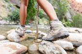 Hiking shoes on river creek — Stock Photo