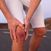 Runner having knee problem — Stock Photo
