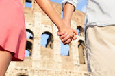 Couple holding hands on travel — Stock Photo