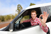 Man driving car showing car keys — Stock Photo