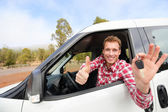 Driver showing car keys and thumb up — Stock Photo