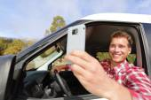 Driver taking photo with smartphone — Foto de Stock