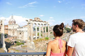 Tourists looking at landmark in Rome — Stock Photo