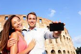 Couple showing smartphone in Rome — Stock Photo