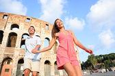 Couple in Rome by Colosseum running — Stock Photo
