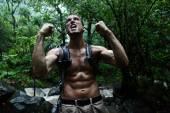 Man cheering in jungle rainforest — Stock Photo