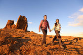 Hikers hiking in beautiful landscape — Stock Photo