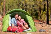 People camping in tent — Stock Photo