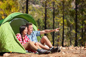 Couple in tent looking at view in forest — Stock Photo