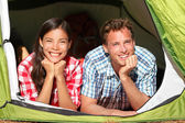 Couple camping in tent looking in forest — Stock Photo