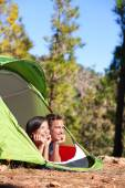 Camping couple in tent looking at forest — Stock Photo