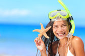 Woman with snorkel and starfish — Stock Photo