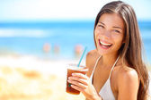 Woman drinking at beach party — Stock Photo