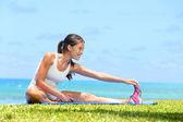 Woman stretching legs — Stock Photo