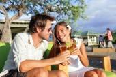 Couple having fun drinking alcohol on beach — Stock Photo