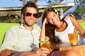 Couple drinking alcohol at beach club — Stock Photo