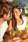 Couple enjoying drinks at beach club — Stock Photo