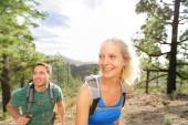 Couple hiking in forest — Stock Photo
