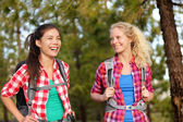 Healthy women hiking in forest — Stock Photo