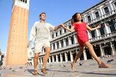 Couple in love having playful fun in Venice — Stock Photo