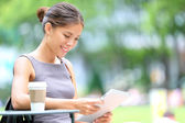 Business woman using tablet on break — Stock Photo