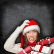 Woman wearing santa hat looking angry — Stock Photo #54891429