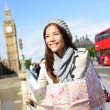 Woman holding map by Big Ben — Stock Photo #54891519