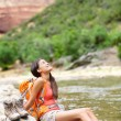 Hiker woman resting feet in river — Stock Photo #54891559