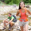 Hikers trekking by river water creek in forest — Stock Photo #54891577