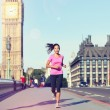 Woman running near Big Ben — Stock Photo #54891639