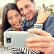 Lovers taking selfie with smart phone — Stock Photo #54891669