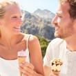 Couple eating ice cream cone — Stok fotoğraf #54892051
