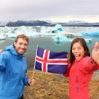 Couple holding Icelandic flag — Stock Photo #54892511