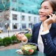 Business woman on smartphone in lunch break — Stock Photo #54892609