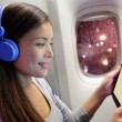 Passenger using tablet computer in airplane — Stock Photo #54892749